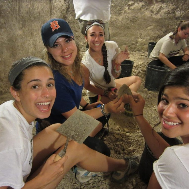 group of girls digging